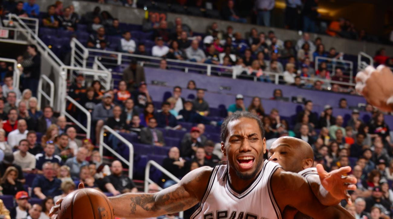 PHOENIX, AZ - JANUARY 21: Kawhi Leonard #2 of the San Antonio Spurs drives against the Phoenix Suns on January 21, 2016, at Talking Stick Resort Arena in Phoenix, Arizona. (Photo by Barry Gossage/NBAE via Getty Images)