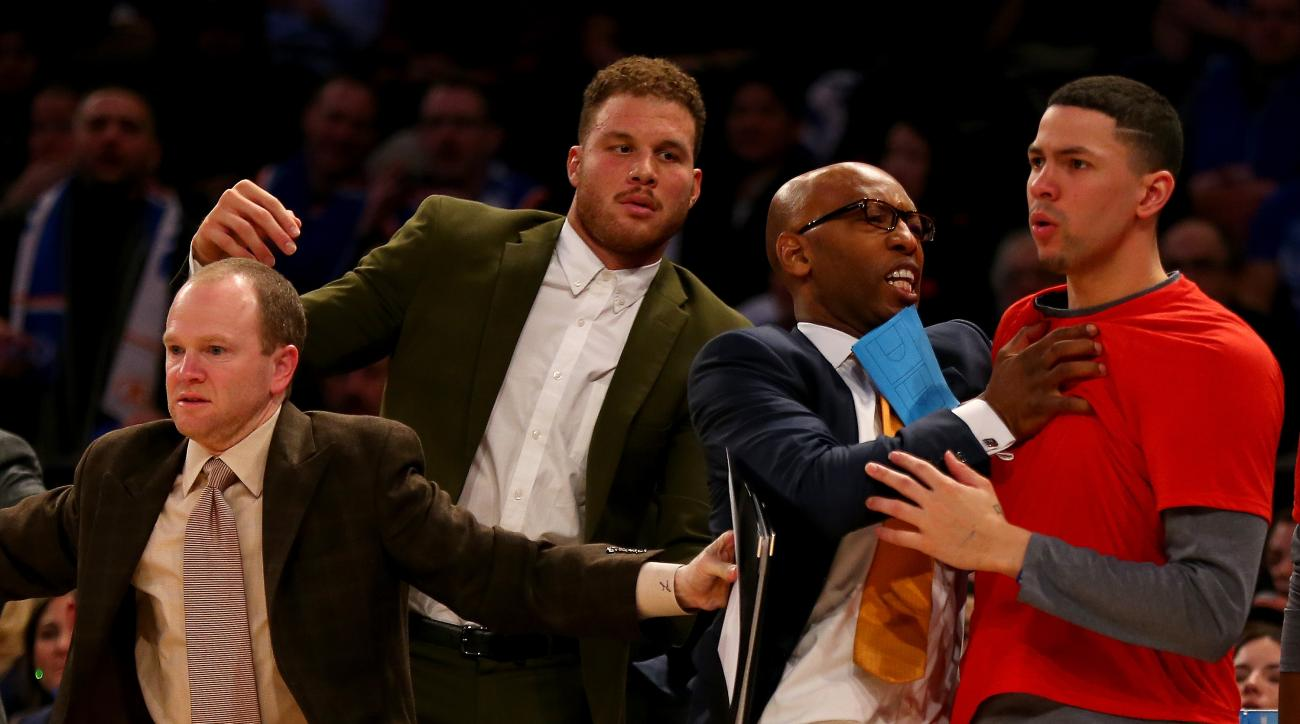 NEW YORK, NY - JANUARY 22:  Austin Rivers #25 of the Los Angeles Clippers is held back by Sam Cassell and Blake Griffin as players from the New York Knicks and the Los Angeles Clippers exchange words on the court at Madison Square Garden on January 22, 20