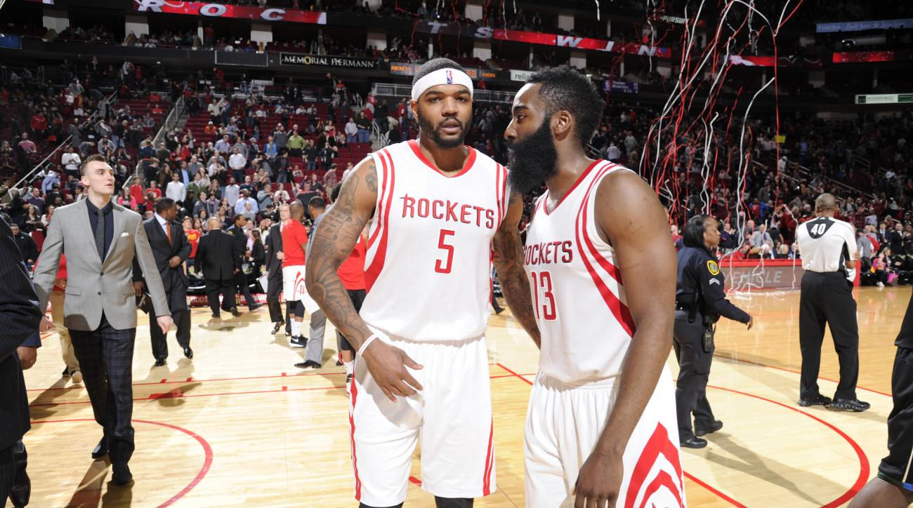 HOUSTON, TX - JANUARY 22:  Josh Smith #5 of the Houston Rockets and James Harden #13 of the Houston Rockets celebrate after the game against the Milwaukee Bucks on January 22, 2016 at the Toyota Center in Houston, Texas. (Photo by Bill Baptist/NBAE via Ge