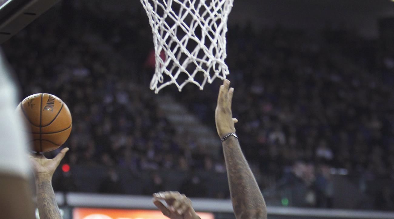 Indiana Pacers center Jordan Hill (27) shoots over Sacramento Kings defender DeMarcus Cousins (15) during the first half of an NBA basketball game in Sacramento, Calif., on Saturday, Jan. 23, 2016. (AP Photo/Steve Yeater)