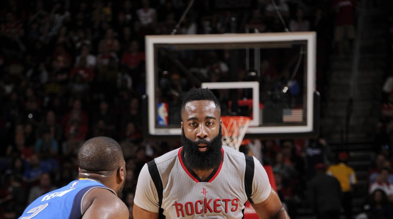HOUSTON, TX - JANUARY 24: James Harden #13 of the Houston Rockets handles the ball during the game against the Dallas Mavericks on January 24, 2016 at the Toyota Center in Houston, Texas. (Photo by Bill Baptist/NBAE via Getty Images)