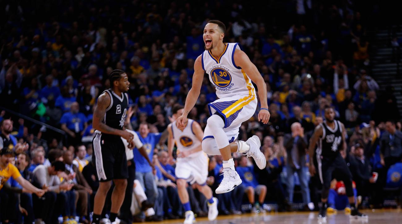 OAKLAND, CA - JANUARY 25:  Stephen Curry #30 of the Golden State Warriors reacts after he made a shot against the San Antonio Spurs in the third quarter at ORACLE Arena on January 25, 2016 in Oakland, California. (Photo by Ezra Shaw/Getty Images)