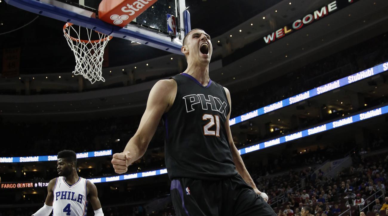 Phoenix Suns' Alex Len reacts after a dunk during the first half of an NBA basketball game against the Philadelphia 76ers, Tuesday, Jan. 26, 2016, in Philadelphia. (AP Photo/Matt Slocum)