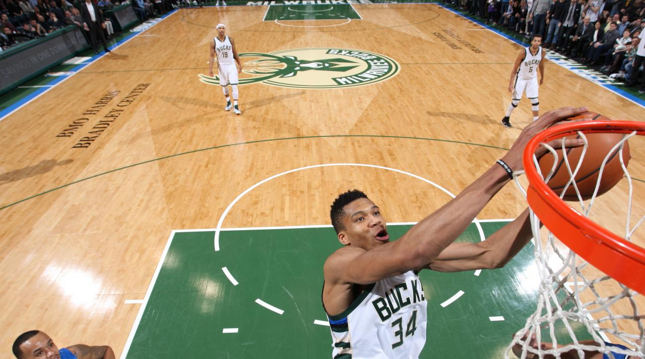 MILWAUKEE, WI - JANUARY 26: Giannis Antetokounmpo #34 of the Milwaukee Bucks goes for the lay up against the Orlando Magic during the game on January 26, 2016 at BMO Harris Bradley Center in Milwaukee, Wisconsin. (Photo by Gary Dineen/NBAE via Getty Image