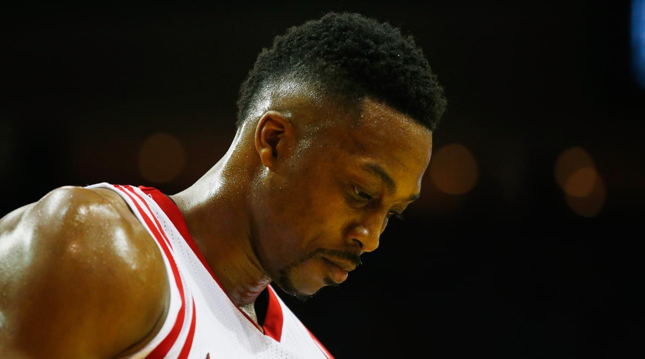 HOUSTON, TX - JANUARY 30:  Dwight Howard #12 of the Houston Rockets walks off the court during their game against the Washington Wizards at the Toyota Center on January 30, 2016  in Houston, Texas. (Photo by Scott Halleran/Getty Images)