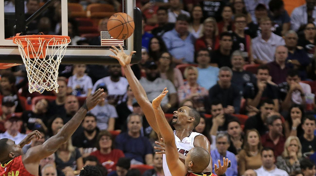 MIAMI, FL - JANUARY 31: Chris Bosh #1 of the Miami Heat shoots over Al Horford #15 of the Atlanta Hawks during a game  at American Airlines Arena on January 31, 2016 in Miami, Florida. (Photo by Mike Ehrmann/Getty Images)