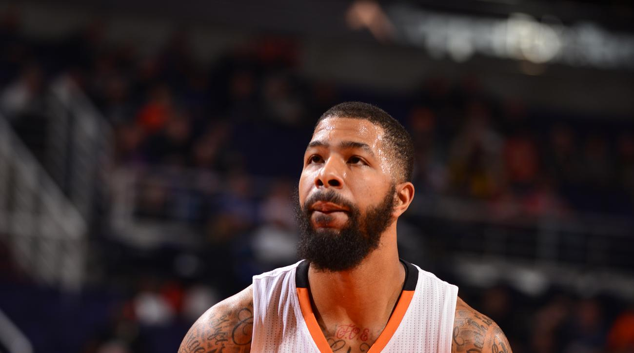 PHOENIX, AZ - FEBRUARY 2:  Markieff Morris #11 of the Phoenix Suns shoots a free throw against the Toronto Raptors on February 2, 2016 at Talking Stick Resort Arena in Phoenix, Arizona. (Photo by Barry Gossage/NBAE via Getty Images)