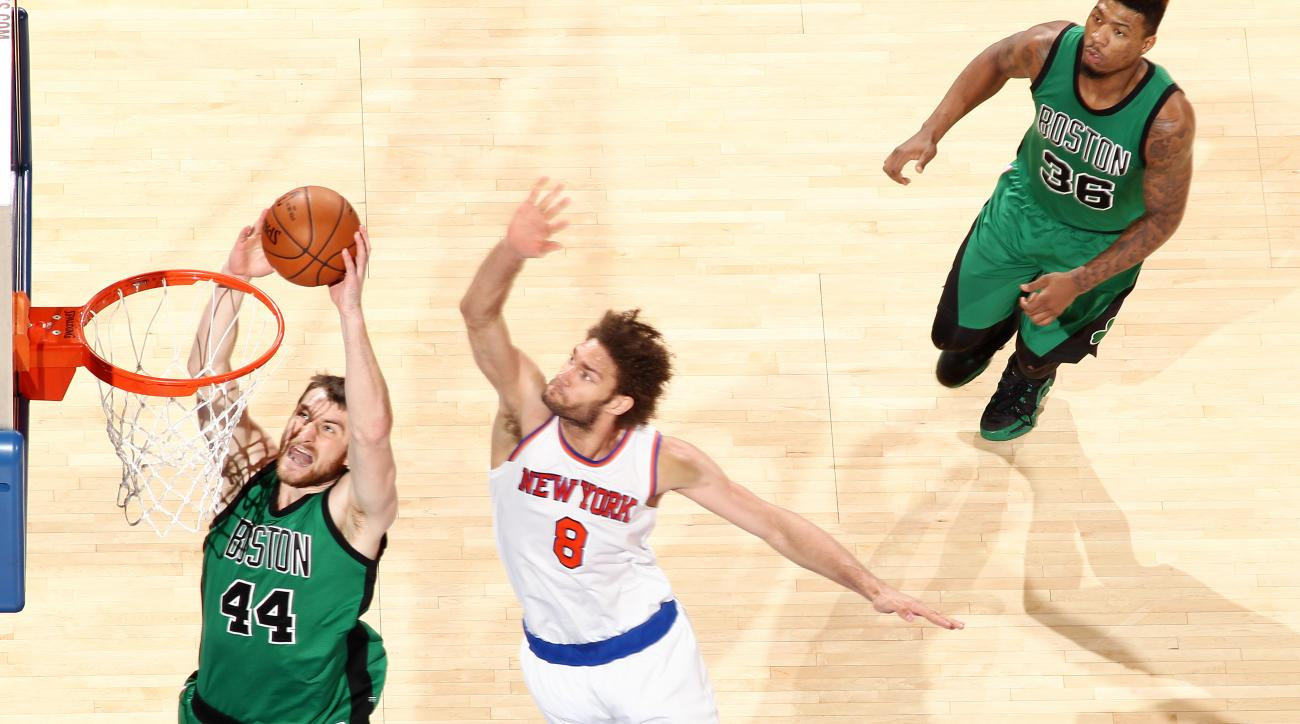 NEW YORK, NY - FEBRUARY 2: Tyler Zeller #44 of the Boston Celtics goes for the lay up against Robin Lopez #8 of the New York Knicks during the game on February 2, 2016 at Madison Square Garden in New York, New York. (Photo by Nathaniel S. Butler/NBAE via
