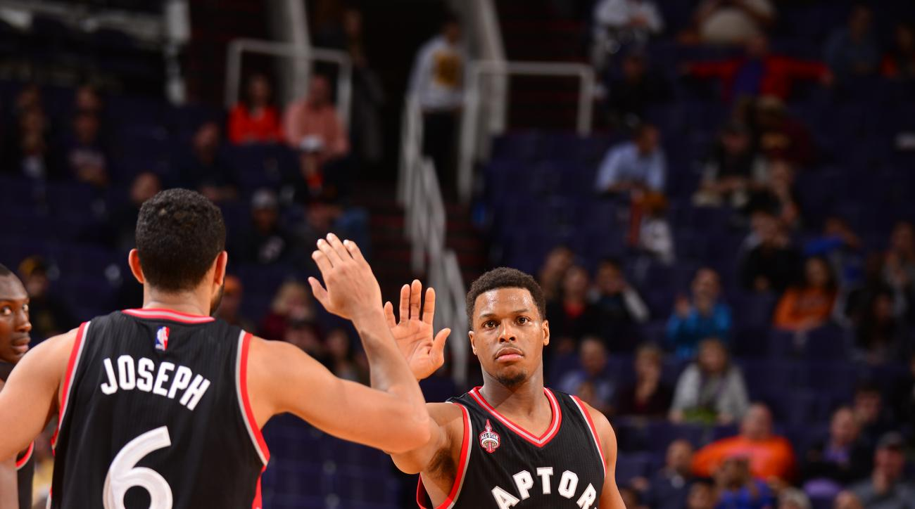 PHOENIX, AZ - FEBRUARY 2:  Kyle Lowry #7 of the Toronto Raptors shakes hands with Cory Joseph #6 of the Toronto Raptors during the game against the Phoenix Suns on February 2, 2016 at Talking Stick Resort Arena in Phoenix, Arizona. (Photo by Barry Gossage