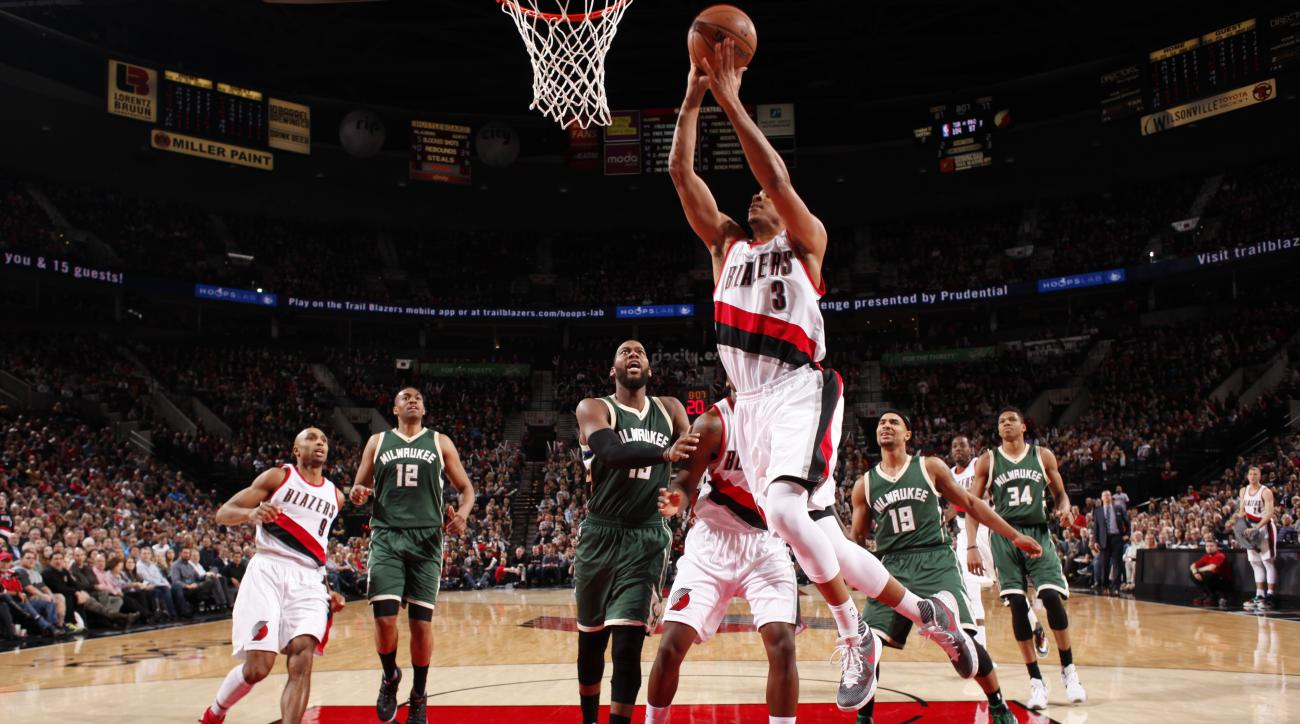 PORTLAND, OR - FEBRUARY 2: C.J. McCollum #3 of the Portland Trail Blazers goes for the lay up against the Milwaukee Bucks during the game on February 2, 2016 at Moda Center in Portland,Oregon. (Photo by Cameron Browne/NBAE via Getty Images)