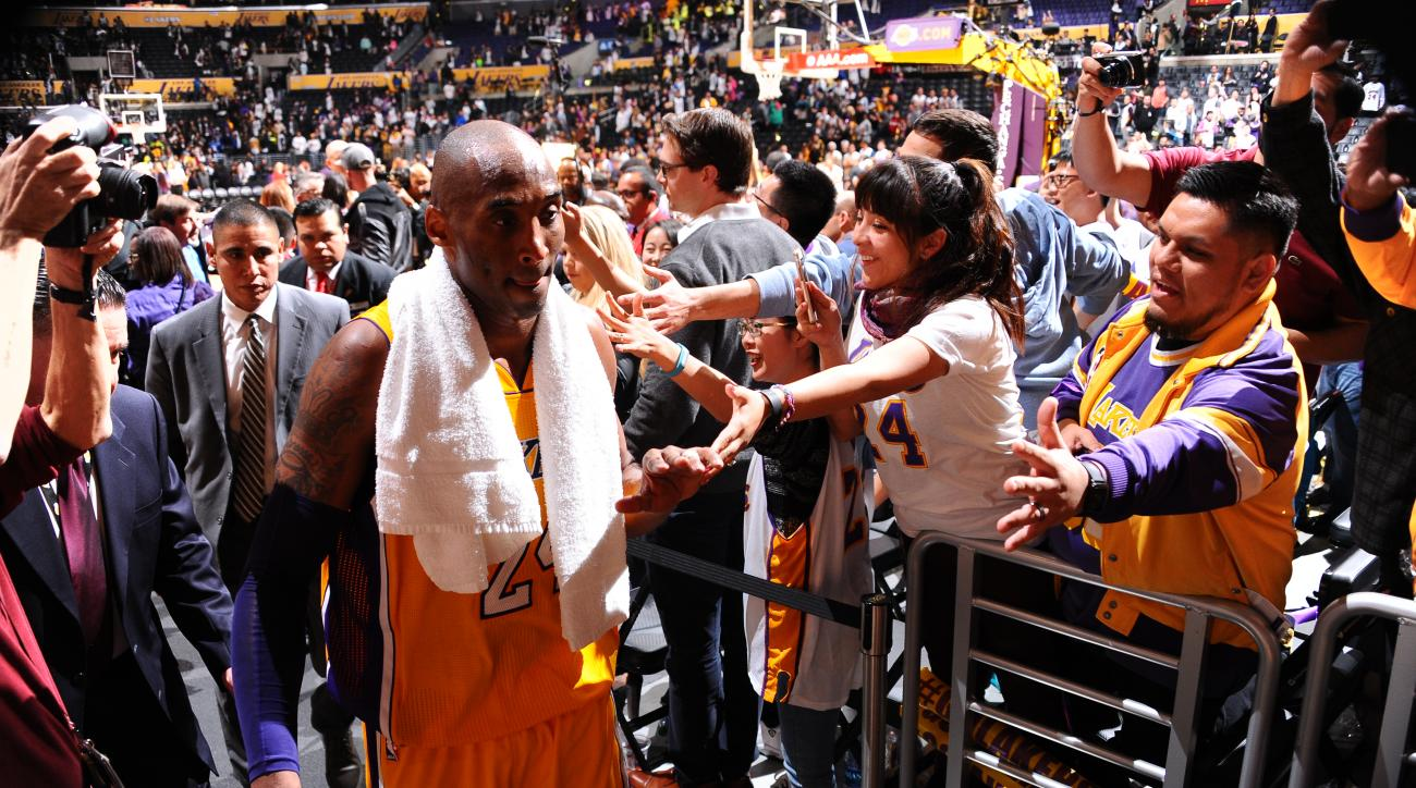 LOS ANGELES, CA - FEBRUARY 2:  Kobe Bryant #24 of the Los Angeles Lakers shakes hands with the fans after the game against the Minnesota Timberwolves on February 2, 2016 at STAPLES Center in Los Angeles, California. (Photo by Juan Ocampo/NBAE via Getty Im
