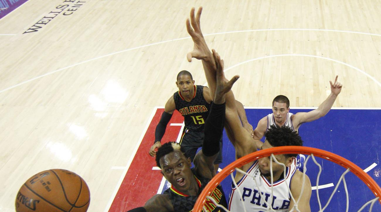 Atlanta Hawks' Dennis Schroder of Germany (17) goes up for the shot with Philadelphia 76ers' Jahlil Okafor (8) defending during the first half of an NBA basketball game, Wednesday, Feb. 3, 2016, in Philadelphia. (AP Photo/Chris Szagola)