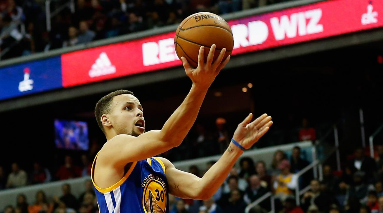 WASHINGTON, DC - FEBRUARY 03:  Stephen Curry #30 of the Golden State Warriors puts up a shot against the Washington Wizards in the first half at Verizon Center on February 3, 2016 in Washington, DC. (Photo by Rob Carr/Getty Images)