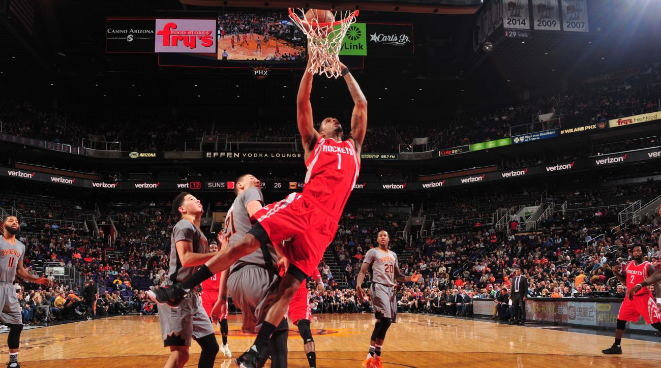 PHOENIX, AZ - FEBRUARY 4: Trevor Ariza #1 of the Houston Rockets shoots the ball against the Phoenix Suns on February 4, 2016 at Talking Stick Resort Arena in Phoenix, Arizona. (Photo by Barry Gossage/NBAE via Getty Images)