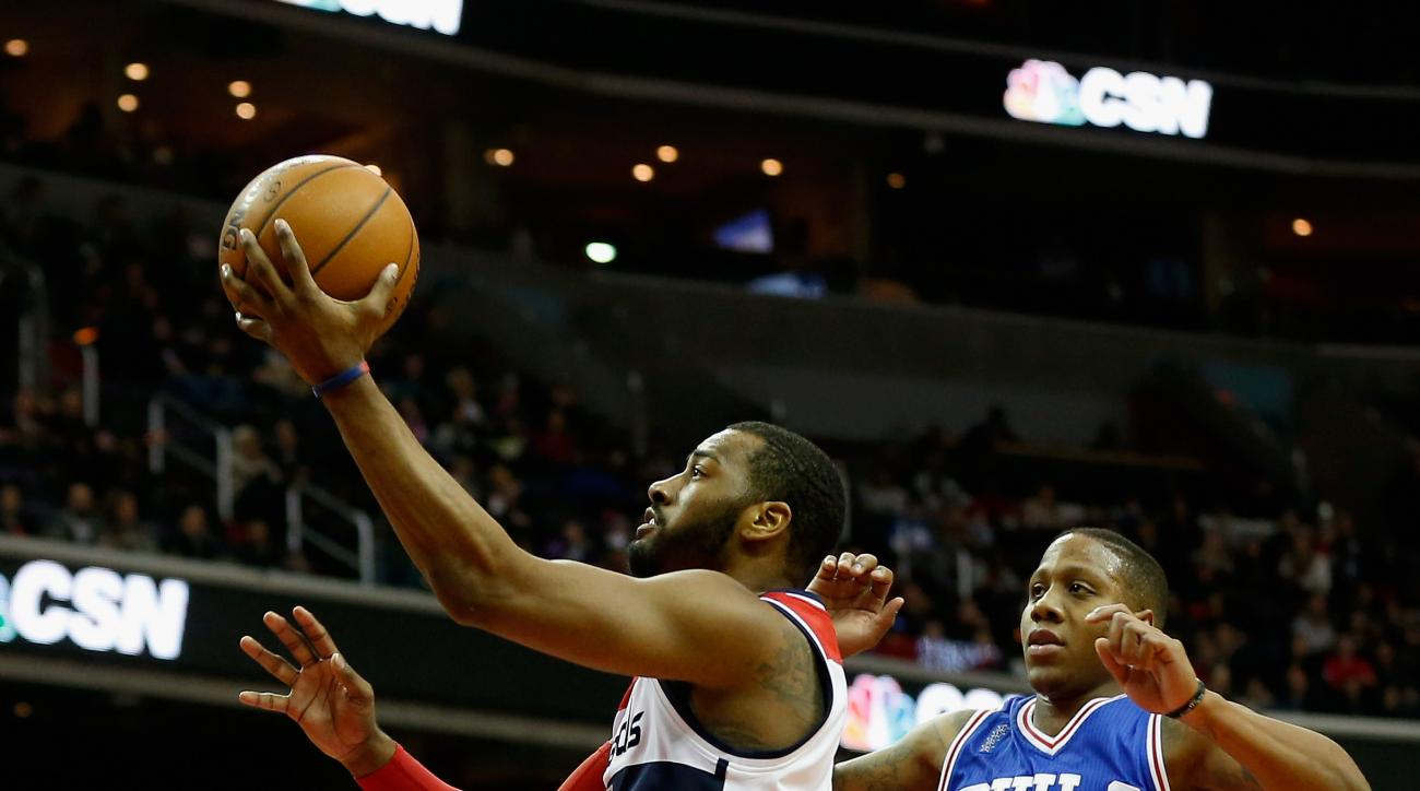 WASHINGTON, DC - FEBRUARY 05: John Wall #2 of the Washington Wizards puts up a shot in front of Isaiah Canaan #0 of the Philadelphia 76ers in the first half at Verizon Center on February 5, 2016 in Washington, DC. (Photo by Rob Carr/Getty Images)