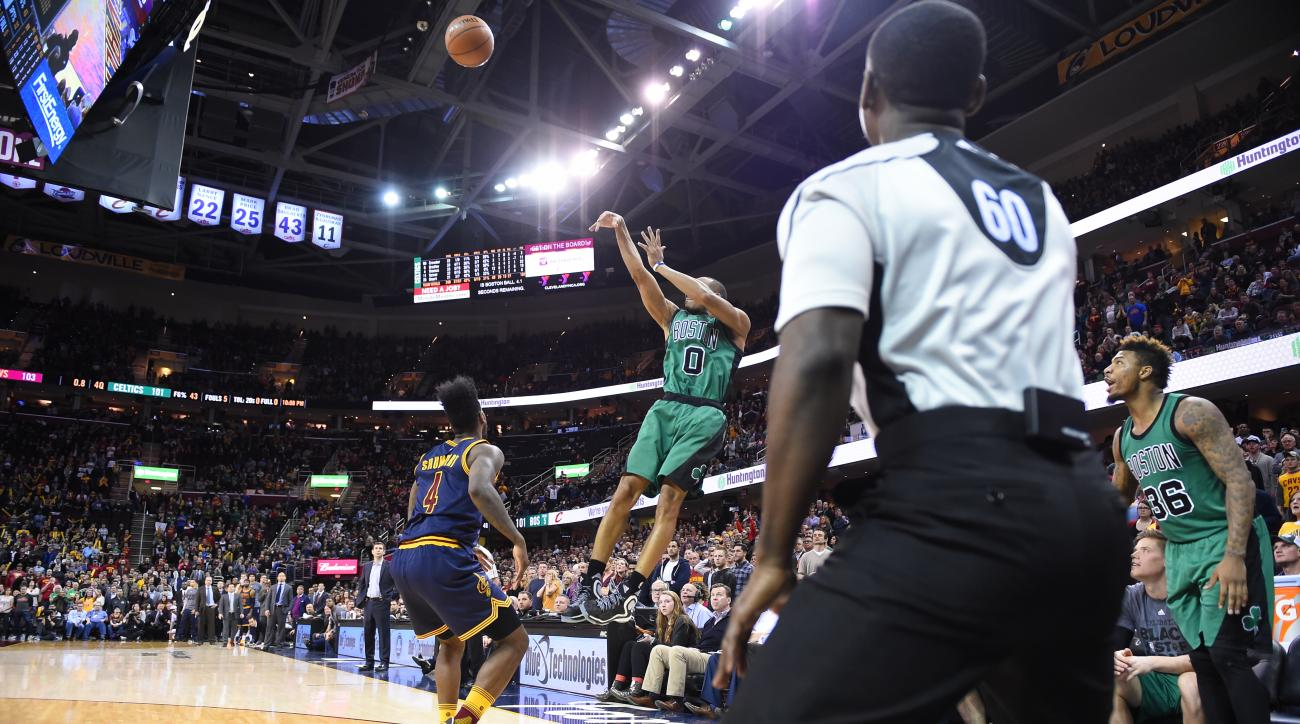 CLEVELAND, OH - FEBRUARY 5: Avery Bradley #0 of the Boston Celtics shoots the three point shot that wins the game against the Cleveland Cavaliers on February 5, 2016 at Quicken Loans Arena in Cleveland, Ohio. (Photo by Brian Babineau/NBAE via Getty Images