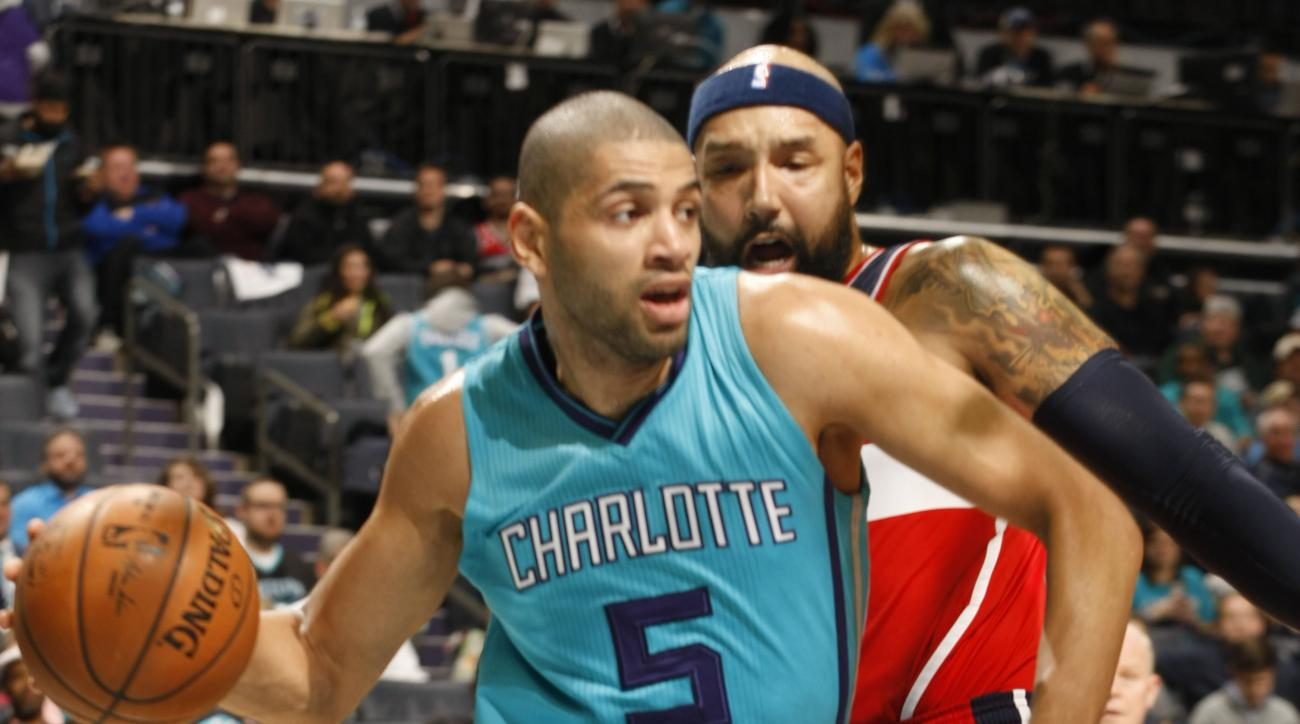 CHARLOTTE, NC - FEBRUARY 06:  Nicolas Batum #5 of the Charlotte Hornets drives past the Washington Wizards during the game at the Time Warner Cable Arena on February 06, 2016 in Charlotte, North Carolina. (Photo by Brock Williams-Smith/NBAE via Getty Imag