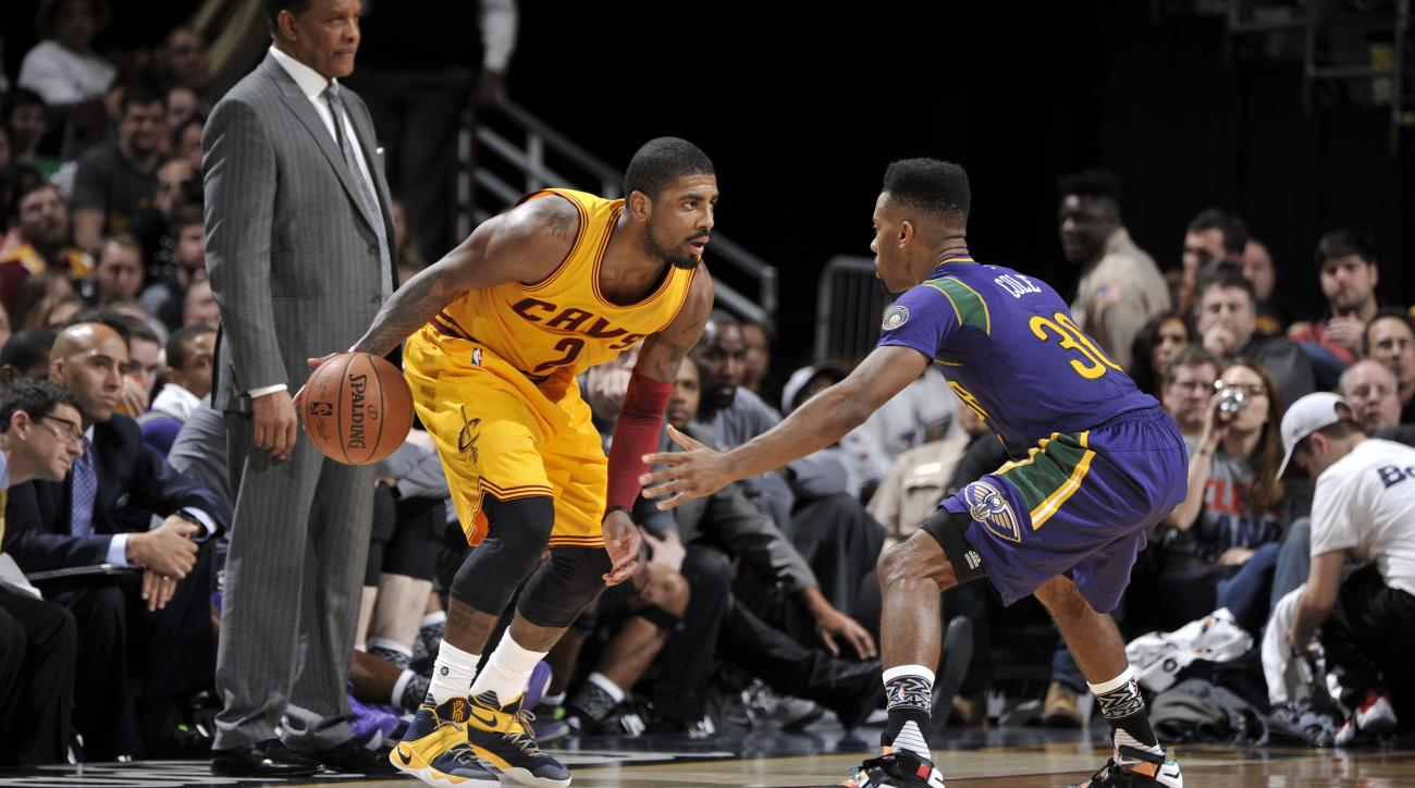 CLEVELAND, OH - FEBRUARY 6:  Kyrie Irving #2 of the Cleveland Cavaliers handles the ball against Norris Cole #30 of the New Orleans Pelicans on February 6, 2016 at Quicken Loans Arena in Cleveland, Ohio. (Photo by David Liam Kyle/NBAE via Getty Images)