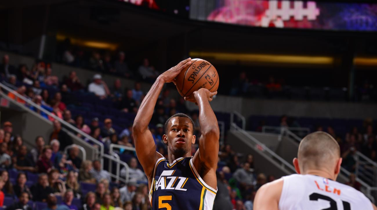 PHOENIX, AZ - FEBRUARY 6:  Rodney Hood #5 of the Utah Jazzshoots against the Phoenix Suns on February 6, 2016 at Talking Stick Resort Arena in Phoenix, Arizona. (Photo by Barry Gossage/NBAE via Getty Images)