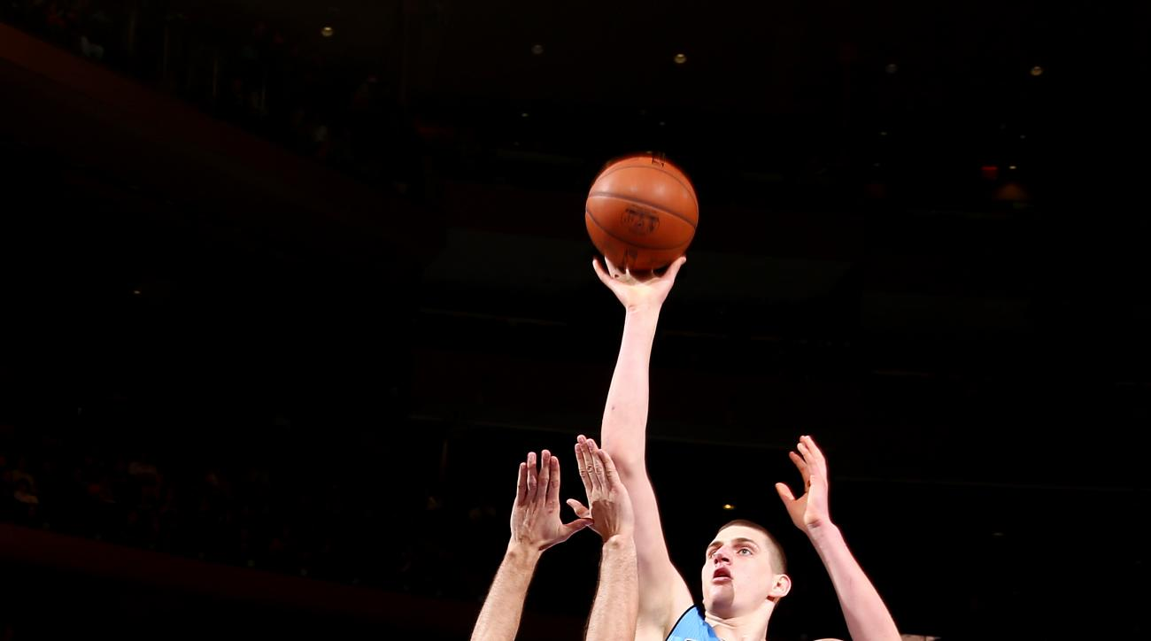 NEW YORK, NY - FEBRUARY 7: Nikola Jokic #15 of the Denver Nuggets shoots the ball during the game against the New York Knicks on February 7, 2016 at Madison Square Garden in New York City, New York.  (Photo by Nathaniel S. Butler/NBAE via Getty Images)