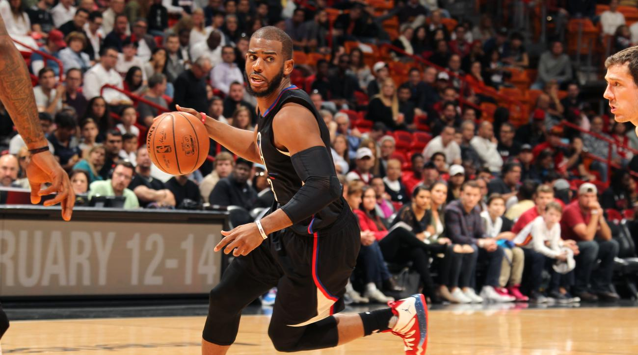 MIAMI, FL - FEBRUARY 7: Chris Paul #3 of the Los Angeles Clippers handles the ball during the game against the Miami Heat on February 7, 2016 at AmericanAirlines Arena in Miami, Florida. (Photo by Issac Baldizon/NBAE via Getty Images)