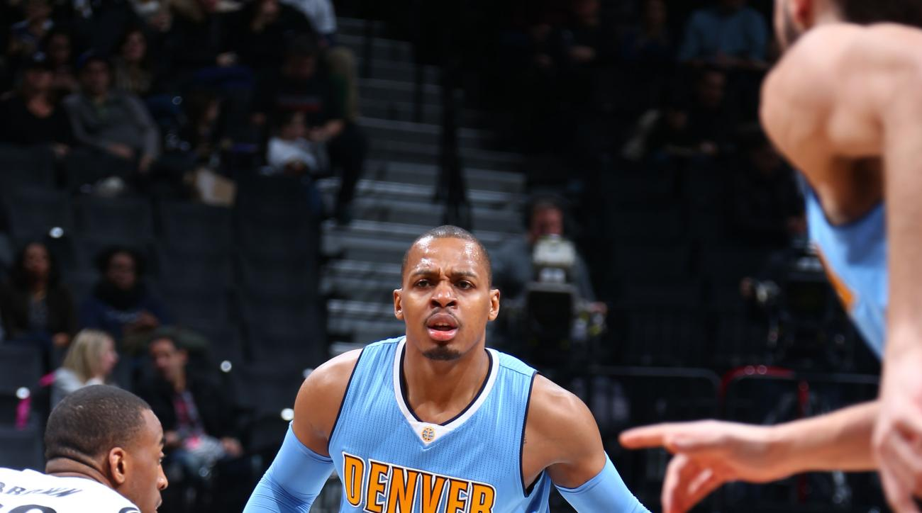 BROOKLYN, NY - FEBRUARY 8: Randy Foye #4 of the Denver Nuggets defends the ball against the Brooklyn Nets during the game on February 8, 2016 at Barclays Center in Brooklyn, New York. (Photo by Nathaniel S. Butler/NBAE via Getty Images)