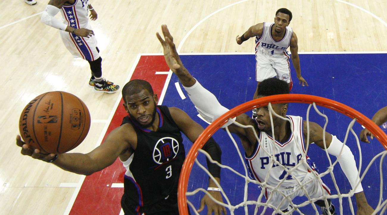 Los Angeles Clippers' Chris Paul (3) goes up for the shot with Philadelphia 76ers' Nerlens Noel (4) defending during overtime of an NBA basketball game, Monday, Feb. 8, 2016, in Philadelphia. The Clippers won 98-92 in overtime. (AP Photo/Chris Szagola)