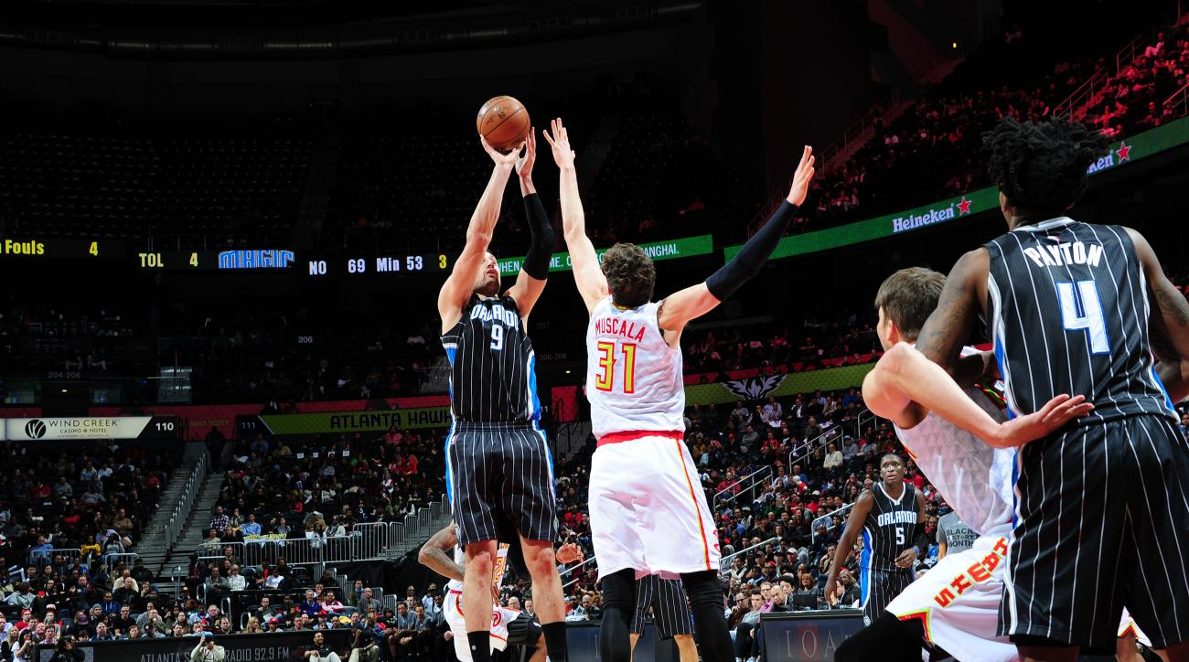 ATLANTA, GA - FEBRUARY 8: Nikola Vucevic #9 of the Orlando Magic shoots the ball against the Atlanta Hawks on February 8, 2016 at Philips Arena in Atlanta, Georgia.  (Photo by Scott Cunningham/NBAE via Getty Images)