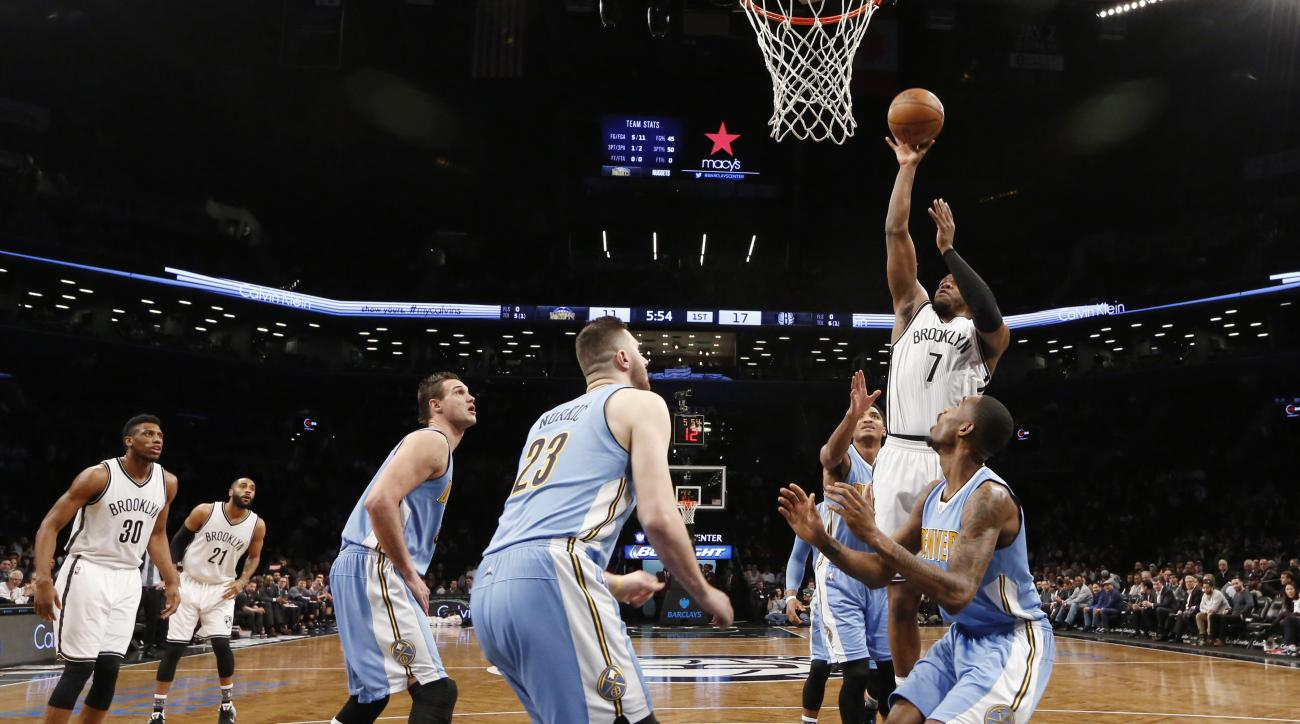 Denver Nuggets defenders, including Nuggets forward Danilo Gallinari (8), Nuggets center Jusuf Nurkic (23) and others defend Brooklyn Nets forward Joe Johnson (7) in the first half of an NBA basketball game, Monday, Feb. 8, 2016, in New York. The Nets def
