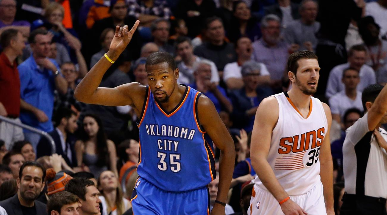 PHOENIX, AZ - FEBRUARY 08:  Kevin Durant #35 of the Oklahoma City Thunder reacts after a three point shot against the Phoenix Suns during the second half of the NBA game at Talking Stick Resort Arena on February 8, 2016 in Phoenix, Arizona.  The Thunder d