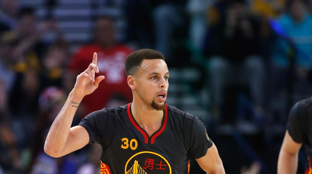 OAKLAND, CA - FEBRUARY 09:  Stephen Curry #30 of the Golden State Warriors reacts after making a basket in the first quarter of their game against the Houston Rockets at ORACLE Arena on February 9, 2016 in Oakland, California.  (Photo by Ezra Shaw/Getty I
