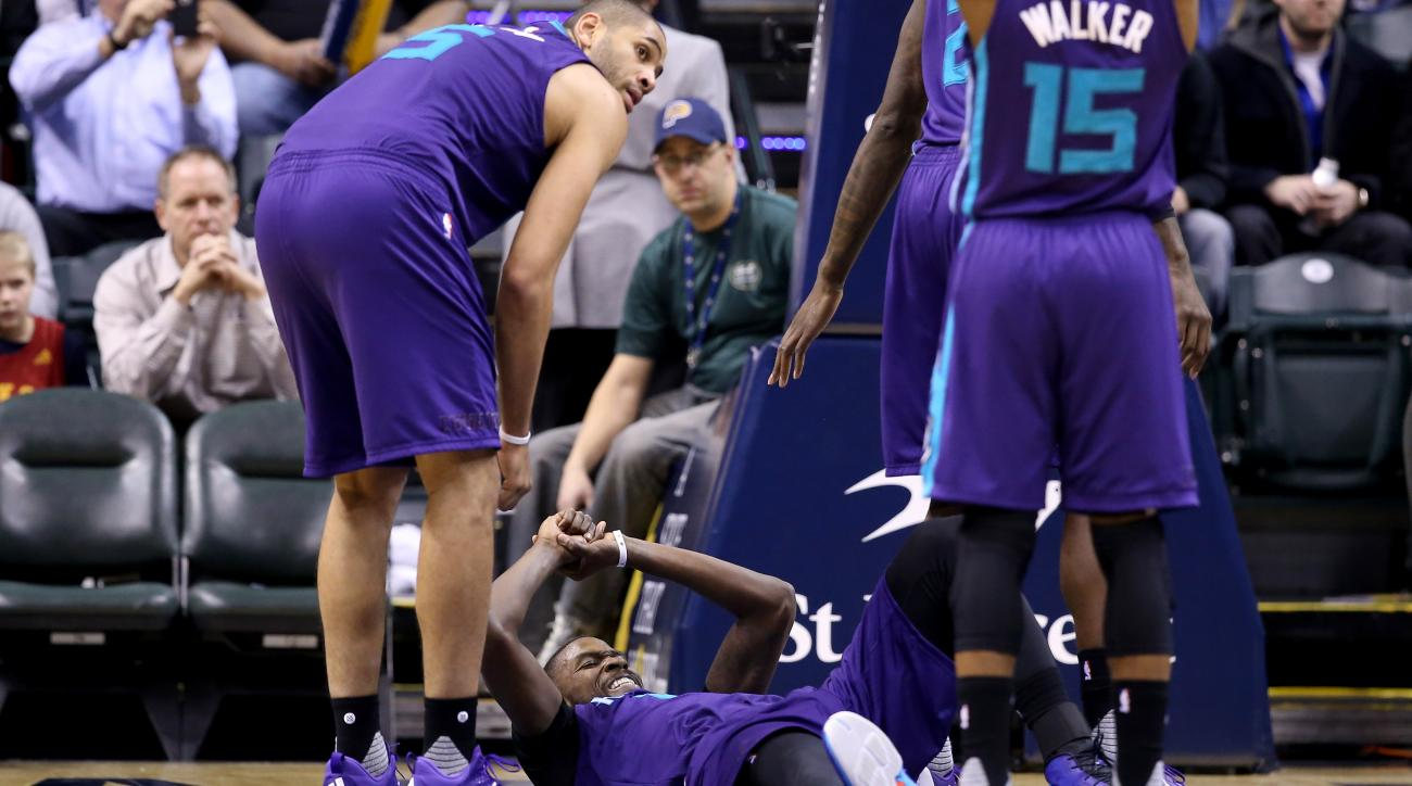 INDIANAPOLIS, IN - FEBRUARY 10:  Michael Kidd-Gilchrist #14 of the Charlotte Hornets grimaces as he lies on the floor after being injured during the game against the Indiana Pacers at Bankers Life Fieldhouse on February 10, 2016 in Indianapolis, Indiana.
