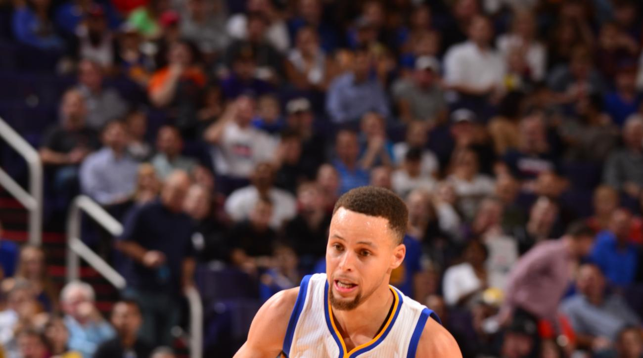 PHOENIX, AZ - FEBRUARY 10: Stephen Curry #30 of the Golden State Warriorsg drives to the basket against the Phoenix Suns during the game on February 10, 2016 at Talking Stick Resort Arena in Phoenix, Arizona. (Photo by Barry Gossage/NBAE via Getty Images)