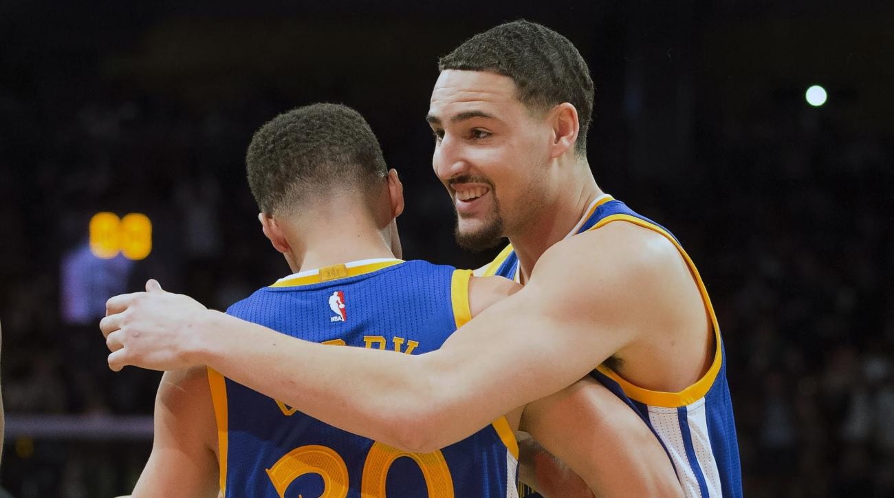 Golden State Warriors guard Klay Thompson (11) hugs Golden State Warriors guard Stephen Curry (30) after winning the three point competition at the NBA all-star weekend in Toronto on Saturday, Feb. 13, 2016. (Mark Blinch/The Canadian Press via AP) MANDATO