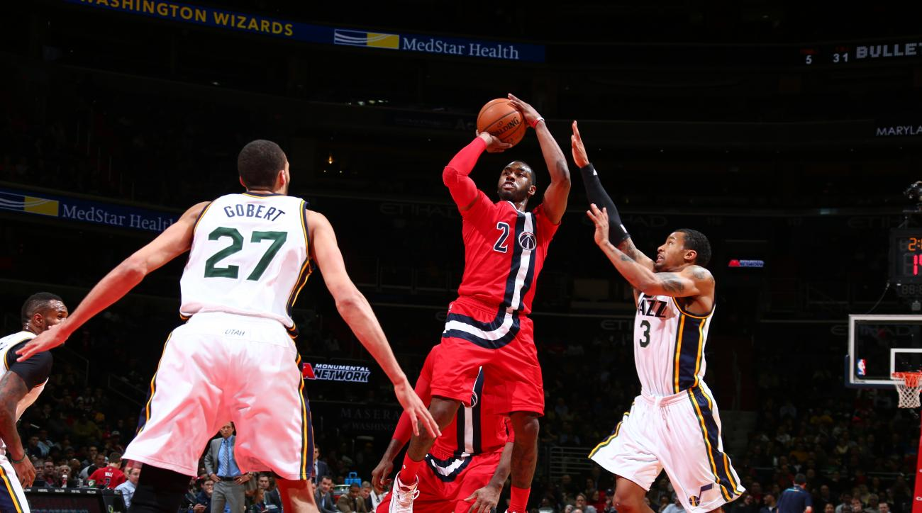 WASHINGTON, DC -  FEBRUARY 18: John Wall #2 of the Washington Wizards shoots the ball against the Utah Jazz on February 18, 2016 at Verizon Center in Washington, DC. (Photo by Ned Dishman/NBAE via Getty Images)