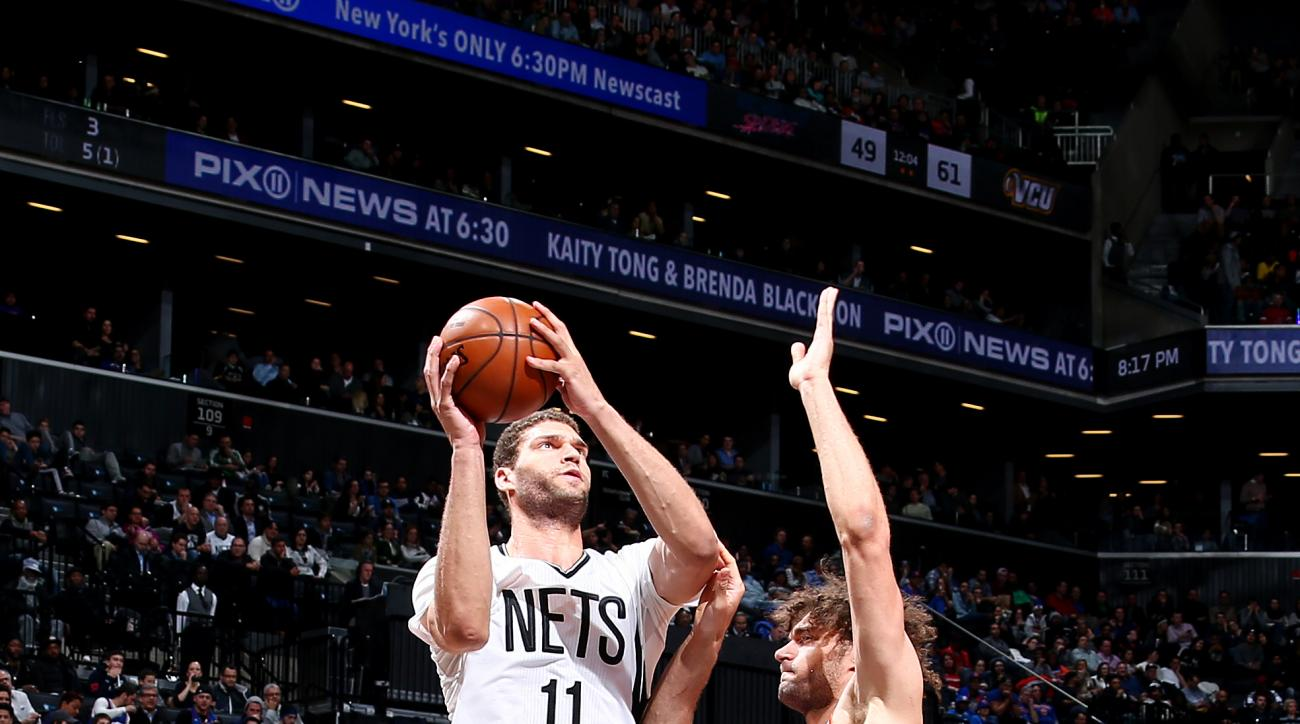 BROOKLYN, NY - FEBRUARY 19: Brook Lopez #11 of the Brooklyn Nets shoots the ball against Robin Lopez #8 of the New York Knicks on February 19, 2016 at Barclays Center in Brooklyn, New York. (Photo by Nathaniel S. Butler/NBAE via Getty Images)