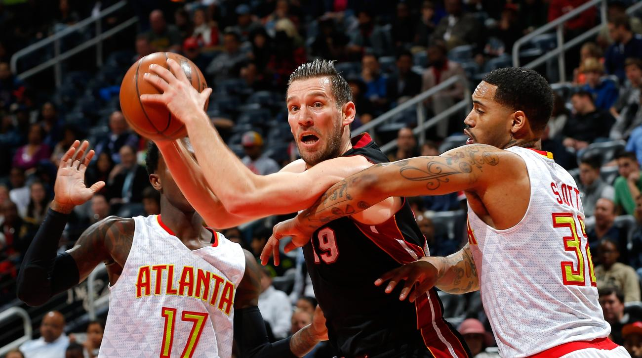 ATLANTA, GA - FEBRUARY 19:  Beno Udrih #19 of the Miami Heat drives against Mike Scott #32 of the Atlanta Hawks at Philips Arena on February 19, 2016 in Atlanta, Georgia.  NOTE TO USER User expressly acknowledges and agrees that, by downloading and or usi