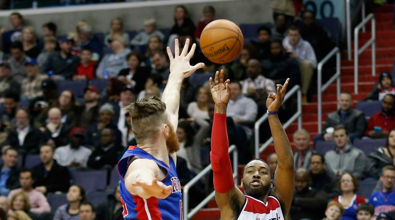 WASHINGTON, DC - FEBRUARY 19: John Wall #2 of the Washington Wizards shoots over Aron Baynes #12 of the Detroit Pistons in the second half of the Wizards 98-86 win at Verizon Center on February 19, 2016 in Washington, DC.  (Photo by Rob Carr/Getty Images)
