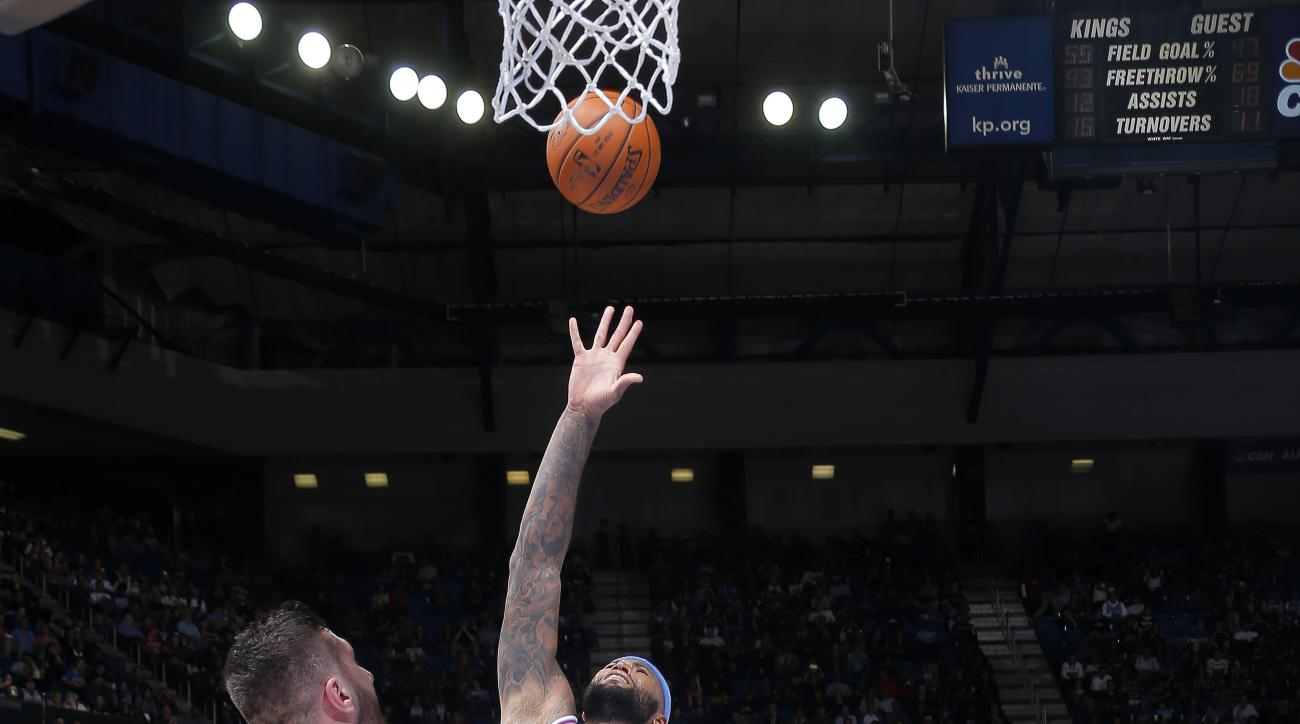 SACRAMENTO, CA - FEBRUARY 19: DeMarcus Cousins #15 of the Sacramento Kings shoots the ball during the game against the Denver Nuggets on February 19, 2016 at Sleep Train Arena in Sacramento, California. (Photo by Rocky Widner/NBAE via Getty Images)