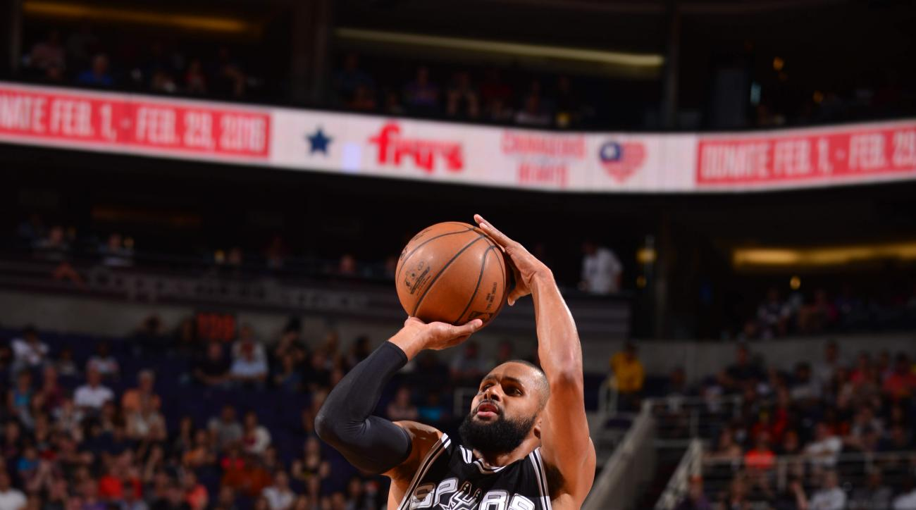 PHOENIX, AZ - FEBRUARY 21:  Patty Mills #8 of the San Antonio Spurs shoots the ball against the Phoenix Suns on February 21, 2016 at Talking Stick Resort Arena in Phoenix, Arizona. (Photo by Barry Gossage/NBAE via Getty Images)