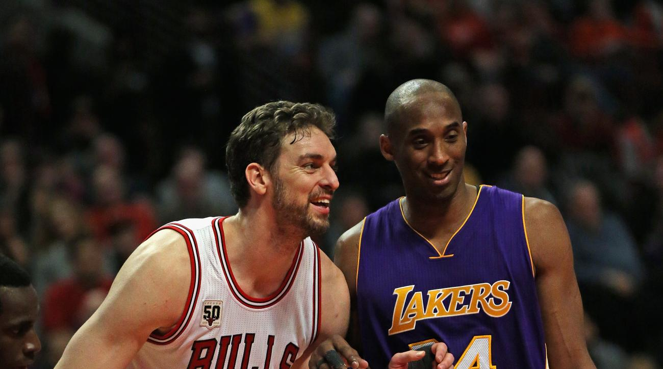 CHICAGO, IL - FEBRUARY 21: Pau Gasol #16 of the Chicago Bulls and Kobe Bryant #24 of the Los Angeles Lakers smile and chat as they await a free-throw at the United Center on February 21, 2016 in Chicago, Illinois. The Bulls defeated the Lakers 126-115. (P