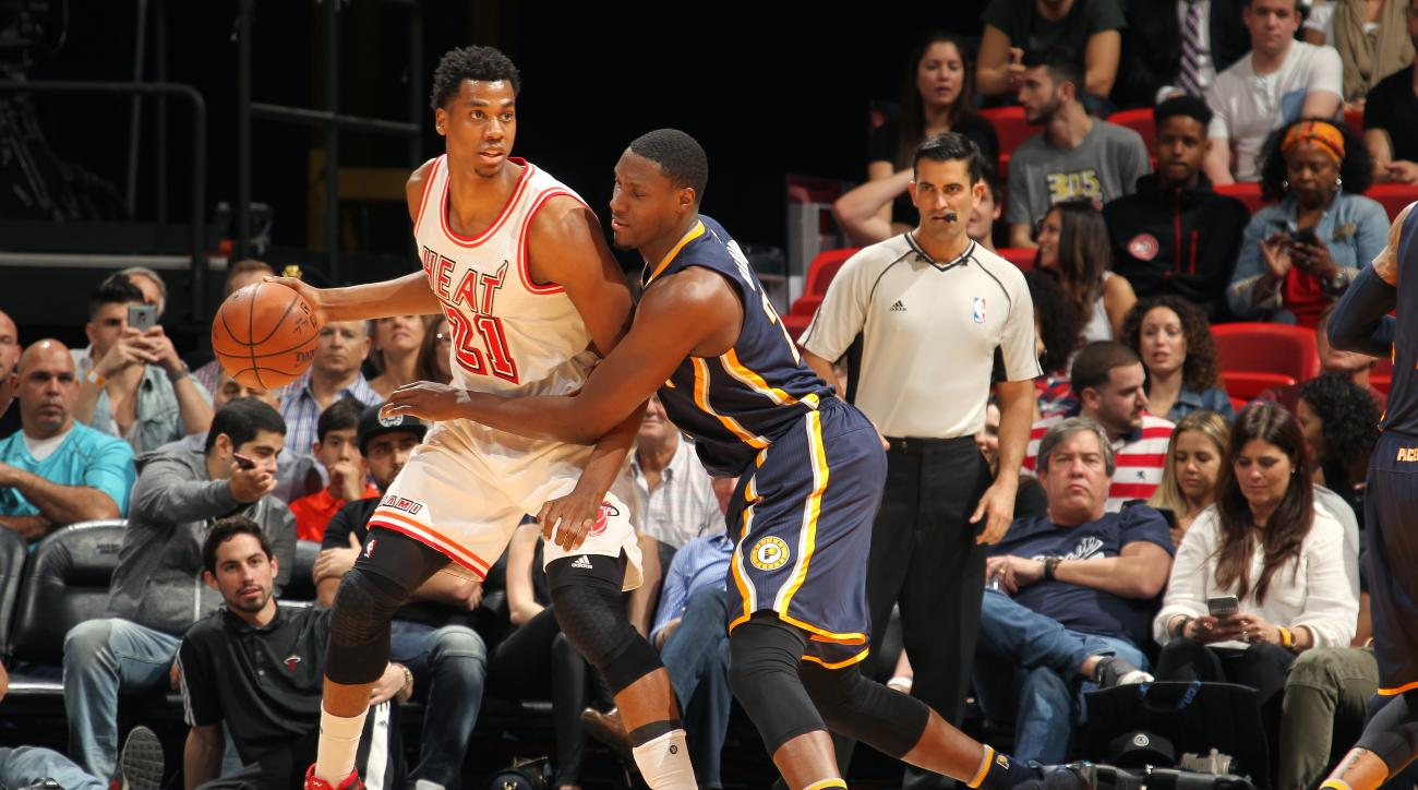 MIAMI, FL - FERBUARY 22: Hassan Whiteside #21 of the Miami Heat handles the ball during the game against the Indiana Pacers on February 22, 2016 at AmericanAirlines Arena in Miami, Florida. (Photo by Issac Baldizon/NBAE via Getty Images)