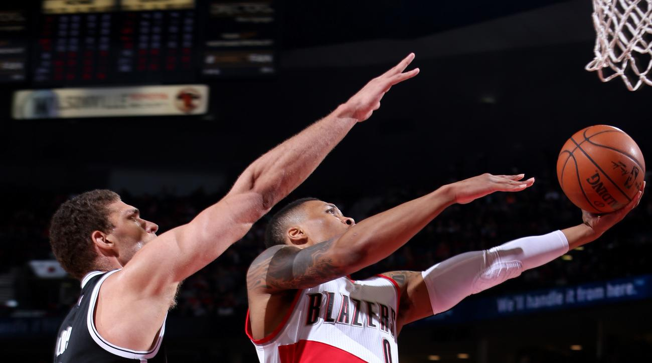 PORTLAND, OR - FEBRUARY 23: Damian Lillard #0 of the Portland Trail Blazers goes for the lay up during the game against the Brooklyn Nets on February 23, 2016 at the Moda Center Arena in Portland, Oregon. (Photo by Sam Forencich/NBAE via Getty Images)