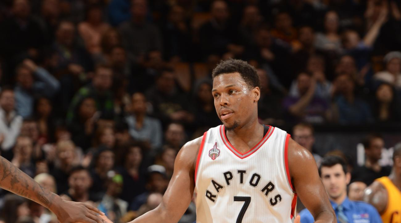 TORONTO, CAN - FEBRUARY 26: Kyle Lowry #7 of the Toronto Raptors high fives teammates during the game against the Cleveland Cavaliers on February 26, 2016 at Air Canada Centre in Toronto, Canada. (Photo by Ron Turenne/NBAE via Getty Images)
