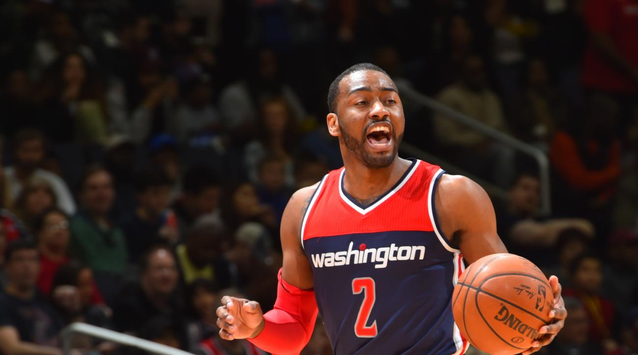 WASHINGTON, DC -FEBRUARY 28: John Wall #2 of the Washington Wizards dribbles up court during the game against the Cleveland Cavilers on February 28, 2015 at Verizon Center in Washington, DC. (Photo by Jesse D. Garrabrant NBAE via Getty Images)