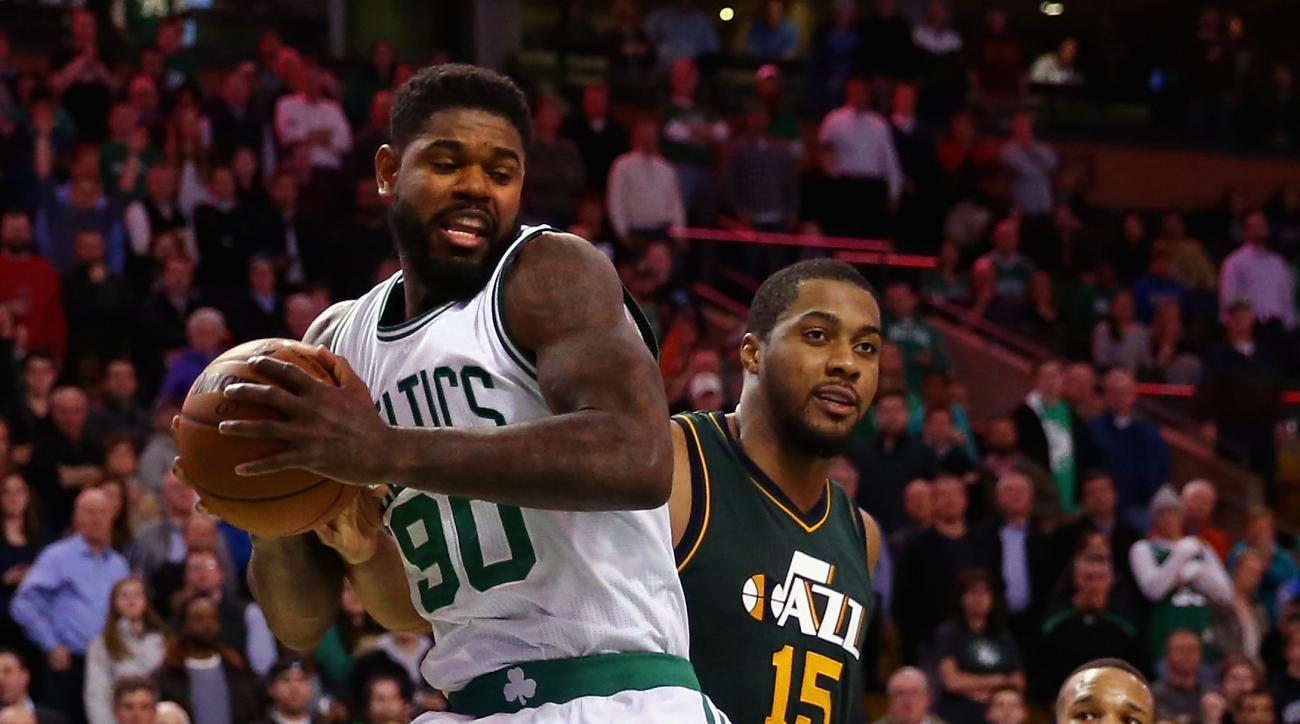 BOSTON, MA - FEBRUARY 29:  Amir Johnson #90 of the Boston Celtics grabs a rebound against Derrick Favors #15 of the Utah Jazz  during the fourth quarter at TD Garden on February 29, 2016 in Boston, Massachusetts. The Celtics defeat the Jazz 100-95.  (Phot