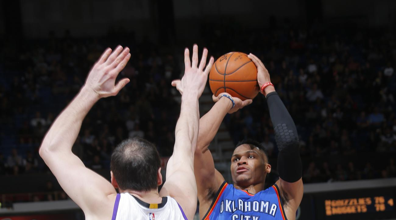 SACRAMENTO, CA - FEBRUARY 29:  Russell Westbrook #0 of the Oklahoma City Thunder shoots against Kosta Koufos #41 of the Sacramento Kings on February 29, 2016 at Sleep Train Arena in Sacramento, California. (Photo by Rocky Widner/NBAE via Getty Images)