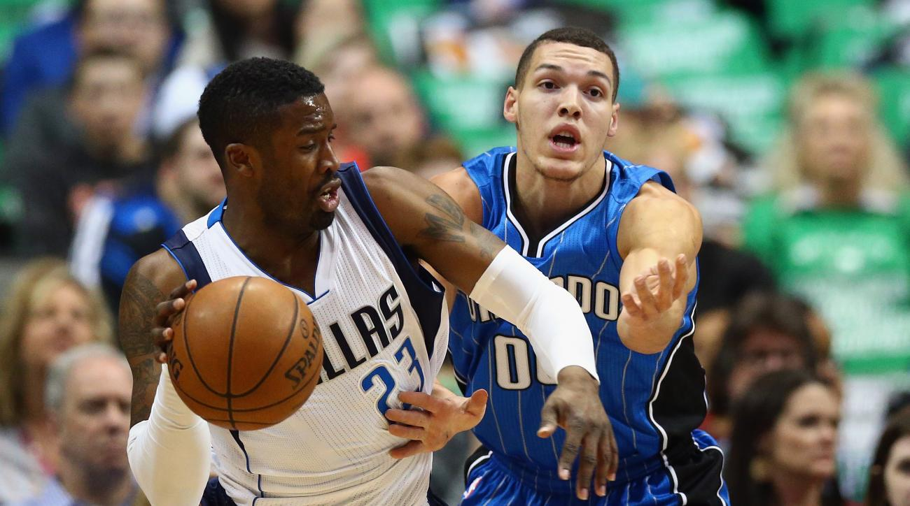 DALLAS, TX - MARCH 01:  Wesley Matthews #23 of the Dallas Mavericks dribbles the ball against Aaron Gordon #00 of the Orlando Magic during the first half at American Airlines Center on March 1, 2016 in Dallas, Texas.   (Photo by Ronald Martinez/Getty Imag