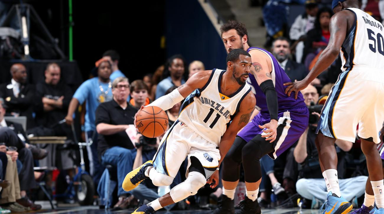 MEMPHIS, TN - MARCH 2: Mike Conley #11 of the Memphis Grizzlies drives to the basket during the game against the Sacramento Kings on March 2, 2016 at FedExForum in Memphis, Tennessee. (Photo by Joe Murphy/NBAE via Getty Images)