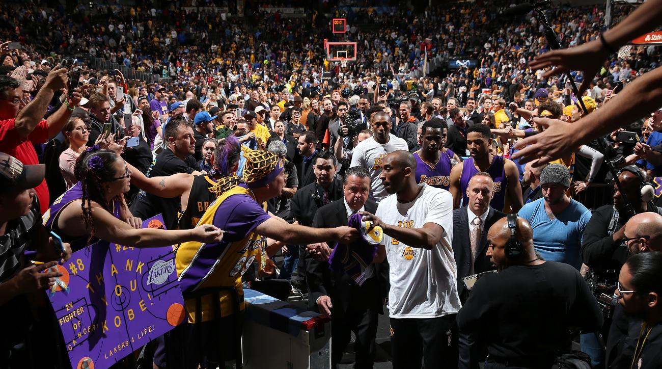 DENVER, CO - MARCH 02:  Kobe Bryant #24 of the Los Angeles Lakers passes through a sea of fans as he leaves the court after facing the Denver Nuggets at Pepsi Center on March 2, 2016 in Denver, Colorado. The Nuggets defeated the Lakers 117-107. (Photo by